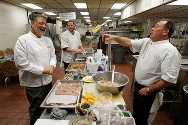 Tim Schafer, right, seems to be enjoying himself in the Perona Farms kitchen.