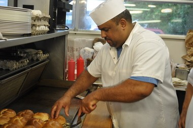 Juan Pena Rodriguez behind the grill at White Rose System, Highland Park.