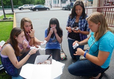 When in doubt, eat in the parking lot. The Munchers make quick work of a cake outside Gencarelli's in Bloomfield.