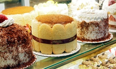 Part of the glittering lineup of cakes at Natale's Summit Bakery.