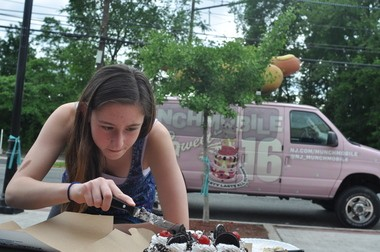 Allie Davanzo is a study in concentration outside Pinho's in Roselle.