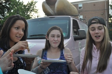 14 pieces of cake later, the Munchers were still at it. From left, Hannah Abrego, Allie Davanzo and Julia Blake.