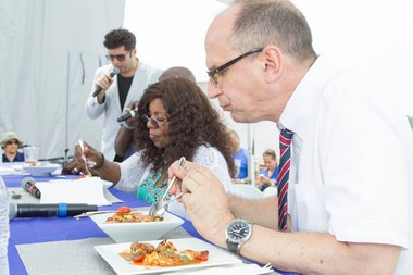 Judge James Oseland compares voodoo shrimp prepared by Bobby Flay and Andrew Araneo at a throwdown in Keyport.
