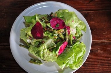 A bibb lettuce salad with shaved beets, roasted asparagus, toasted pistachios, orange zest and mint buttermilk dressing at Porta in Asbury Park.