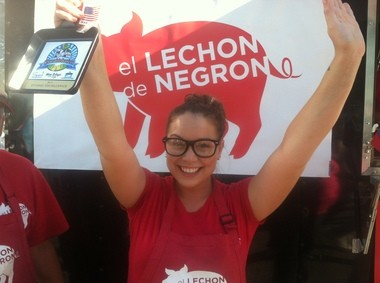 Tiffany Negron seems pretty happy with the Ethic Excellence award given to El Lechon de Negron.