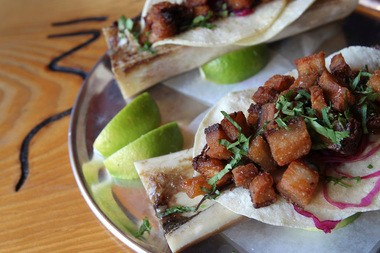 Orale Mexican Kitchen's taco machin — roasted bone marrow with pork belly and shredded cabbage.