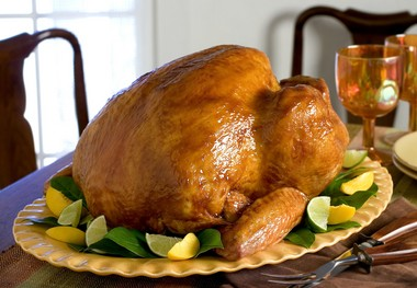 A Glazed Butterball turkey for the Thanksgiving table centerpiece, is displayed. The glaze gives the skin a golden glow that's both great to look at and to taste, with a combination of sweet barbecue sauce, coffee and cumin.
