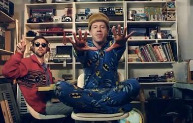 Atypical hip-hop gear: Ryan Lewis and Macklemore, in his footies.