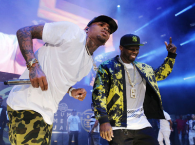 Chris Brown, left, and 50 Cent performed on the Summer Jam main stage Sunday.