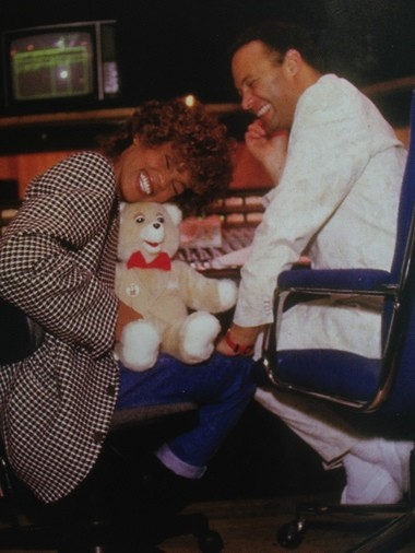 Whitney Houston hugs a teddy bear gifted to here by producer Narada Michael Walden. Walden said he did all he could to keep her upbeat and relaxed while recording. (Courtesy of Tarpan Studios)