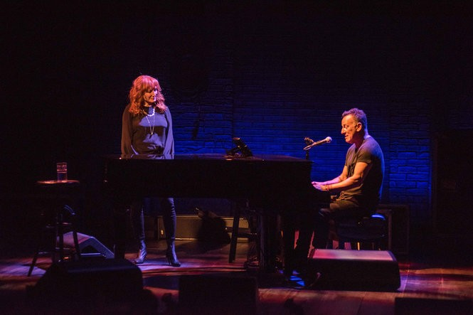 "Patti Scialfa and Bruce Springsteen on stage for ""Springsteen on Broadway"" at the Walter Kerr Theatre in New York. (Rob DeMartin)"