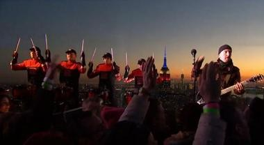 Members of the Rutgers University Drumline stand next to guitarist The Edge as they play a rooftop concert alongside U2 for the first outing of 'The Tonight Show Starring Jimmy Fallon' Monday night.