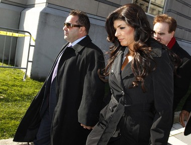 """Joe and Teresa Giudice of """"Real Housewives of New Jersey"""" leave the federal courthouse in Newark in 2013."""
