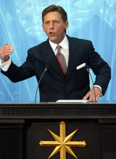 David Miscavige, the leader of Scientology, speaks at the inauguration of Madrid's church in 2004.