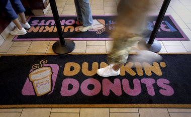 Tyrone D. Harris, of Morristown, allegedly stole $2,000 from a Lafayette Avenue Dunkin' Donuts on his first day of work, police say. In this file photo, a customer enters at a Dunkin' Donuts store in New York.