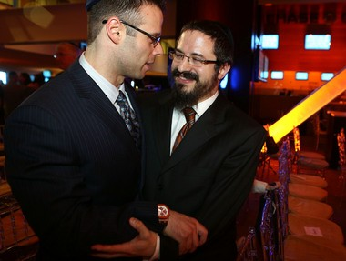 Supporter Brendan Berger hugs Rabbi Zalman Grossbaum after the announcement of the plans for LifeTown during the Friendship Circle's annual benefit at MetLife Stadium on Tuesday.