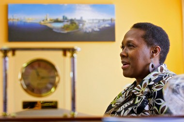 Former Essex County College president Edythe Abdullah during an April 2010 interview in her office on the college campus where she has a panoramic photo of Florida State College of Jacksonville, her former place of employment.