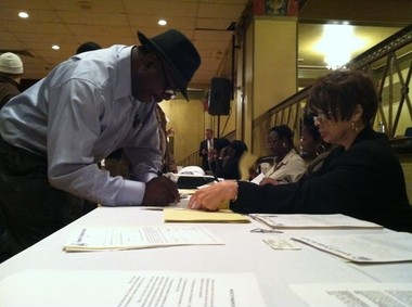 City employees take deposits from winning bidders at today's auction of city properties.