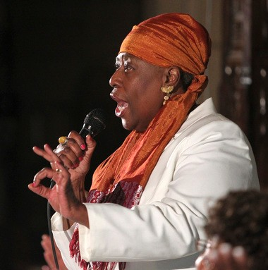 Fredrica Bey, who founded Women in Support of the Million Man March and Adelaide L. Sanford Charter School, speaks out against coverage of her groups in the Sunday-Star-Ledger at a community rally in Newark.