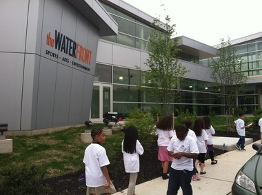 Children walk around the new Waterfront recreation facility, which is seen as a new linchpin in a once-troubled Newark neighborhood.