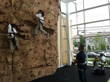 A few kids climb the rock wall at the Waterfront today, as officials cut the ribbon on the new, $9.7-million recreation facility built by the Newark Housing Authority.