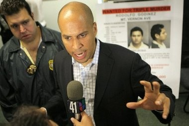 Former Police Chief Anthony Campos (left) is suing Newark Mayor Cory Booker, alleging the mayor failed to deliver on promises he made while negotiating Campos' resignation as chief in 2008.