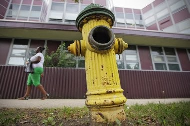 A broken fire hydrant in front of University High School, one of five around the school that are broken or have some other type of problem.
