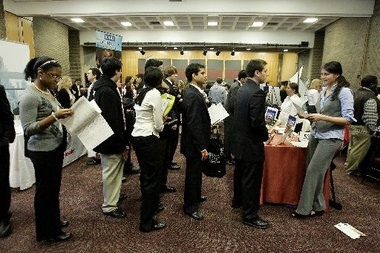 People wait in line to talk with Wiley Publishing recruiter Eva Drew, right, at a job fair at Rutgers University on Wednesday, Jan. 7, 2009, in New Brunswick, N.J.