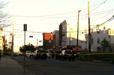 Investigators at the scene of a double homicide at South 10th Street and 15th Avenue in Newark Saturday afternoon.