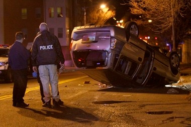 An Essex County Prosecutor's Office vehicle flipped over en route to the scene of a Newark homicide Monday night, leaving one officer and three civilians injured. The collision occurred at the corner of Broad Street and West Kinney Street in Newark.