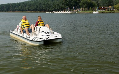Anthony DeMaio and his grandson, also Anthony DeMaio, take a spin during the July 19 opening of the paddle boating and picnic pavilion in the South Mountain Recreation Complex in West Orange.