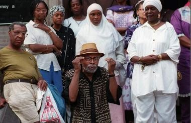 Baraka speaks at a 1997 memorial service for Betty Shabazz in front of the Women In Support of the Million Man March Building in Newark.