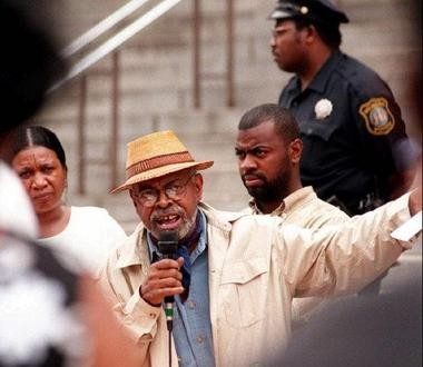 Baraka and other community activists speak on the steps of Newark's City Hall to protest police action taken on the Zoo Crew, a Newark-based gang, while a police shooting remained unsolved.