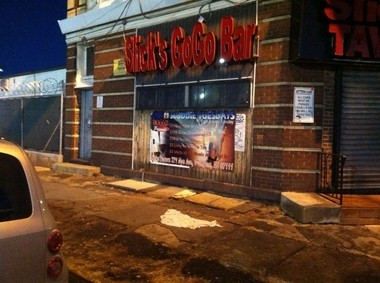 Three people were killed and two were wounded in a shooting early Christmas morning at Slick's Go-Go Bar in Irvington.