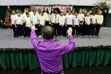 Students from the Branch Brook School sing during the 20th annual Feast of the Three Kings celebration last month. An annual report released today by the Advocates for Children of New Jersey shows statistics saying that life for the city's youths has improved over the last decade - but still lags behind many of their peers statewide.