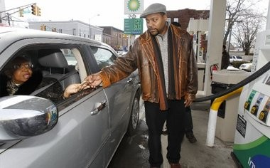 Ann Clayton of Jersey City, left, is skeptical at first when Jemmie Adams, right, offers to give her $10 towards her gas. Adams believes in helping people, so for 30 straight days Adams is doing acts of kindness for complete strangers.
