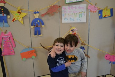 Nathaniel Kraemer of South Orange and Dylan Maguire of Maplewood, students in Ursula Stigliano's class at Open Door Nursery School, stand in front of some of the artwork created by their class.