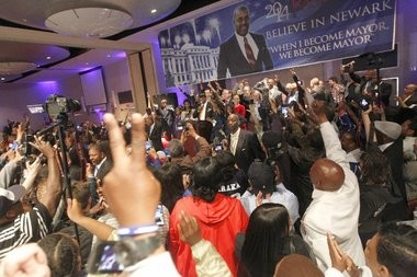 Bedlam erupts on the floor of the Tri-State Ballroom at the Robert Treat in downtown Newark as Ras Baraka flashes the crowd a victory sign after he beat Shavar Jeffries in today's mayoral election in Newark.