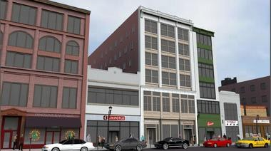 The second phase of Rock Plaza Lofts is complete. Pictured is a rendering of the apartment buildings and retailers.