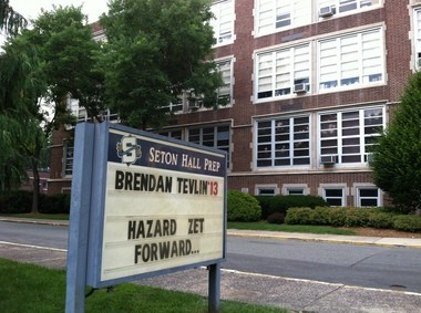 A sign outside Seton Hall Preparatory School in West Orange pays tribute to Brendan Tevlin, a 2013 graduate who was fatally shot in his car in West Orange this week.