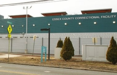 An Essex County corrections officer pleaded guilty today to smuggling marijuana and cell phones into the Essex County Jail.