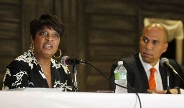 Linda Watkins-Brashear, former executive director of the Newark Watershed Conservation and Development Corp., is one of the defendants named in a class-action lawsuit filed in Essex County. Watkins-Brashear and former Newark Mayor and U.S. Sen. Cory Booker are pictured, left to right, in this file photo.