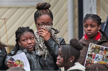 """Unidentified mourners stand outside Funeraria Las Americas on Roseville Avenue following the viewing for 14-year-old Abdul """"Scooter"""" Frazier in January. Frazier was the third teenager shot in the South Ward on Christmas night 2013, and passed away in the hospital three weeks later."""