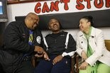 Larry and Rosa Garcia Cureton chat and reminisce with Kevin Brown Thompson at his karate school.