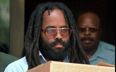 In this July 12, 1995 file photo, convicted cop killer and former death-row resident Mumia Abu-Jamal leaves Philadelphia's City Hall after a hearing. (AP File Photo)