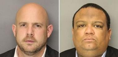 Bloomfield Police Officers Sean Courter and Orlando Trinidad, pictured left to right, when their photos were taken after they were taken into custody on Nov. 5, following their conviction on official misconduct and related charges.