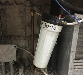 A photograph supplied by the Newark Teachers Union appears to show a lead reduction filter at a city school was installed in September 2013. (Courtesy of Newark Teachers Union)