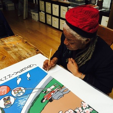 Ringgold signing a print of the artwork. (Courtesy NC 350)