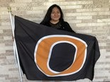 Jenny Rodriguez proudly holds the Orange High School flag. (Allison Pries | NJ Advance Media for NJ.com)