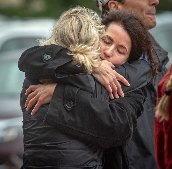 """Stephy's Place, a support center for grief and loss in Red Bank, held a mourning walk with others to remember those they have lost and loved. Event was held at Seven Presidents Park in Long Branch on Sunday, September 9, 2018. Dawn Massabni, Rumson, back to camera) gets a hug from """"dear friend"""" Julia Drechsler, Rumson."""